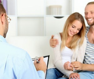 Young happy couple after therapy session with family psychologis